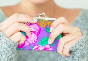 woman-holding-coin-purse_web